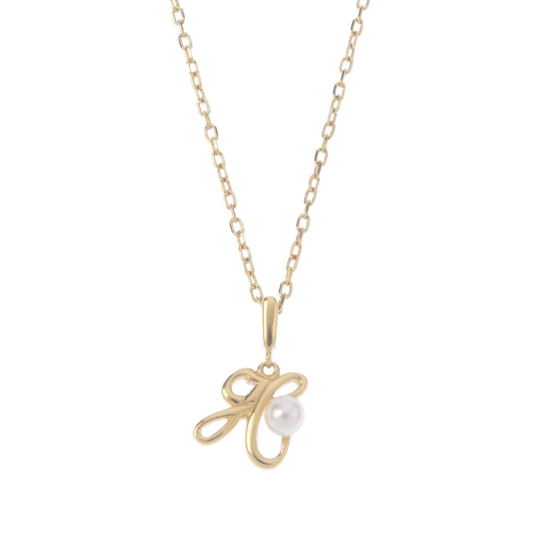 MIKIMOTO - a cultured pearl initial pendant. The letter
