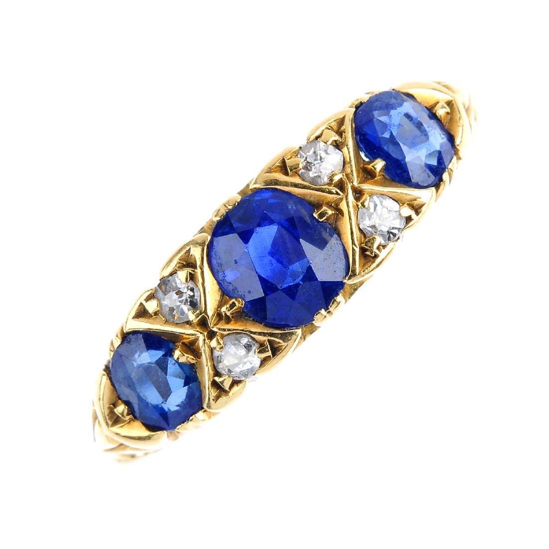 An Edwardian 18ct gold sapphire three-stone and diamond