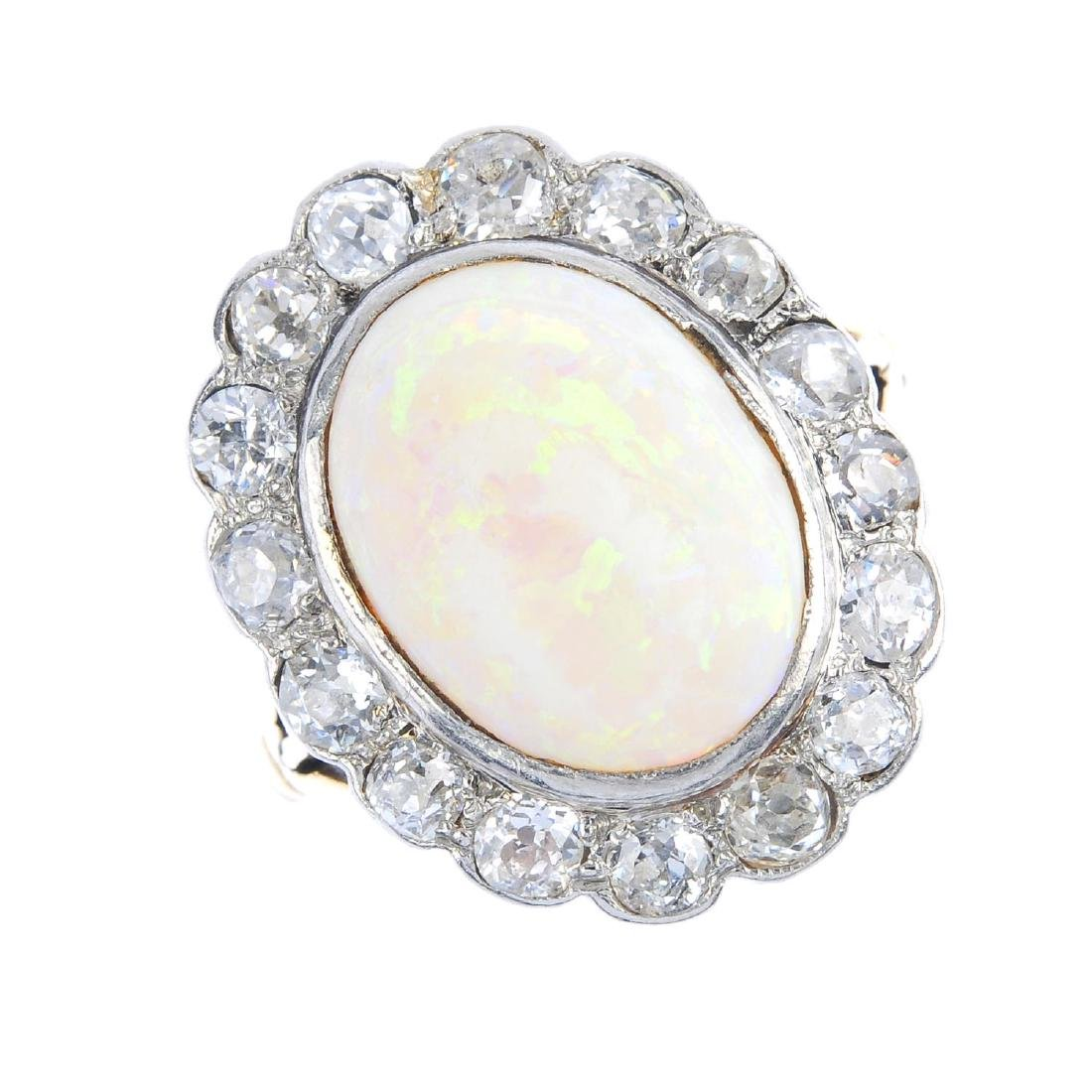 An early 20th century platinum and 18ct gold, opal and