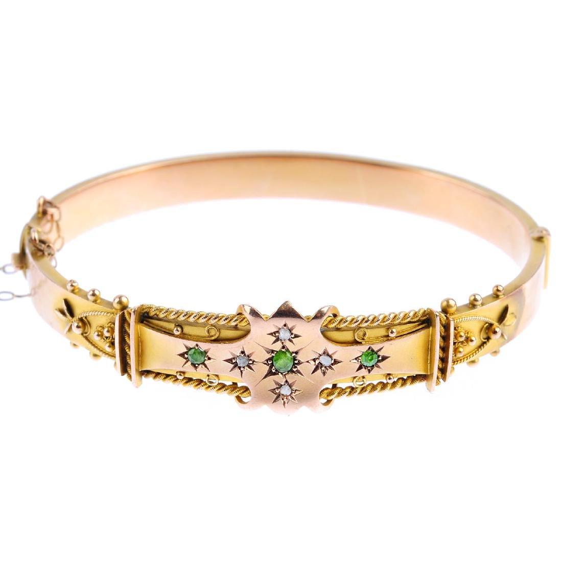 An Edwardian 9ct gold demantoid garnet and diamond