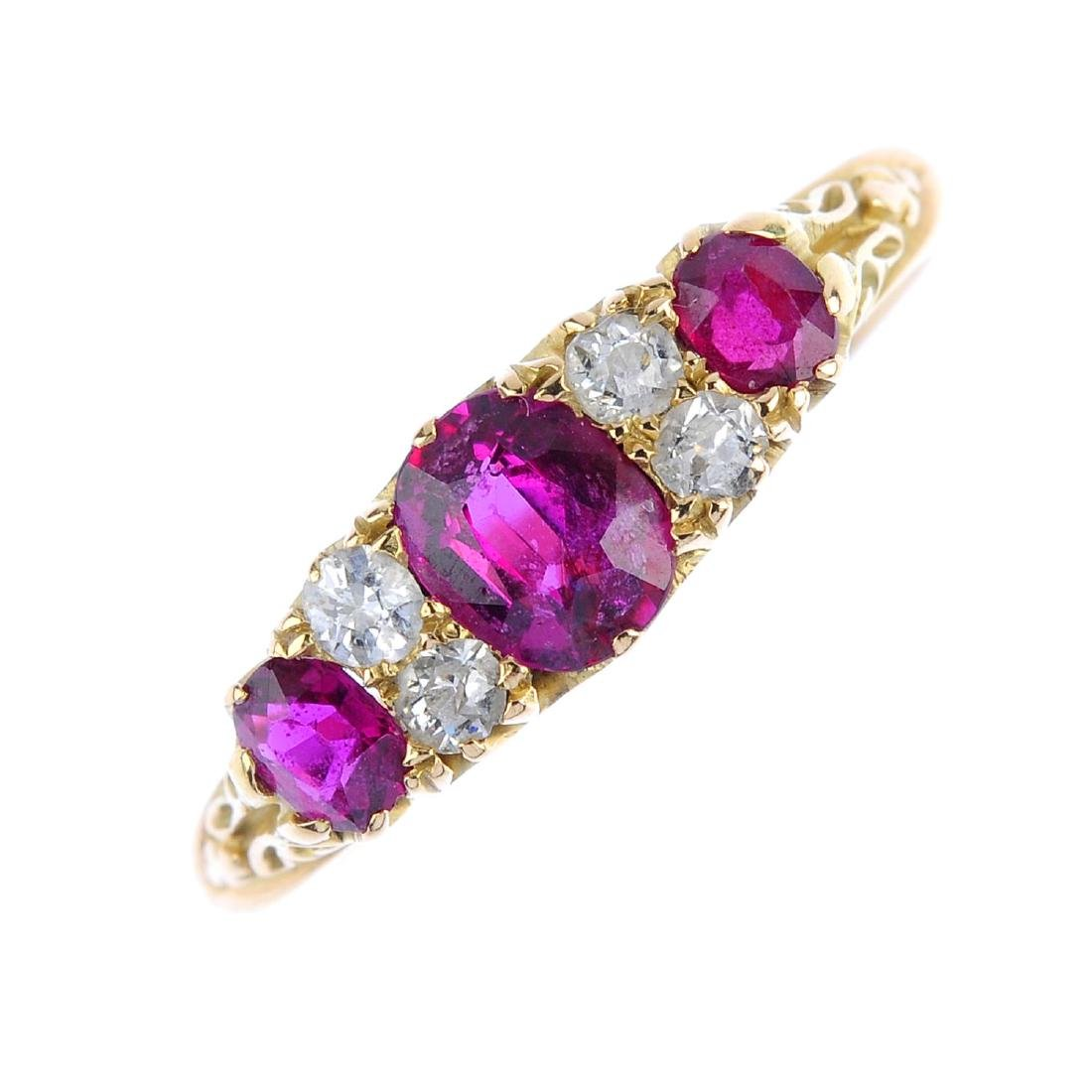An early 20th century 18ct gold ruby three-stone and