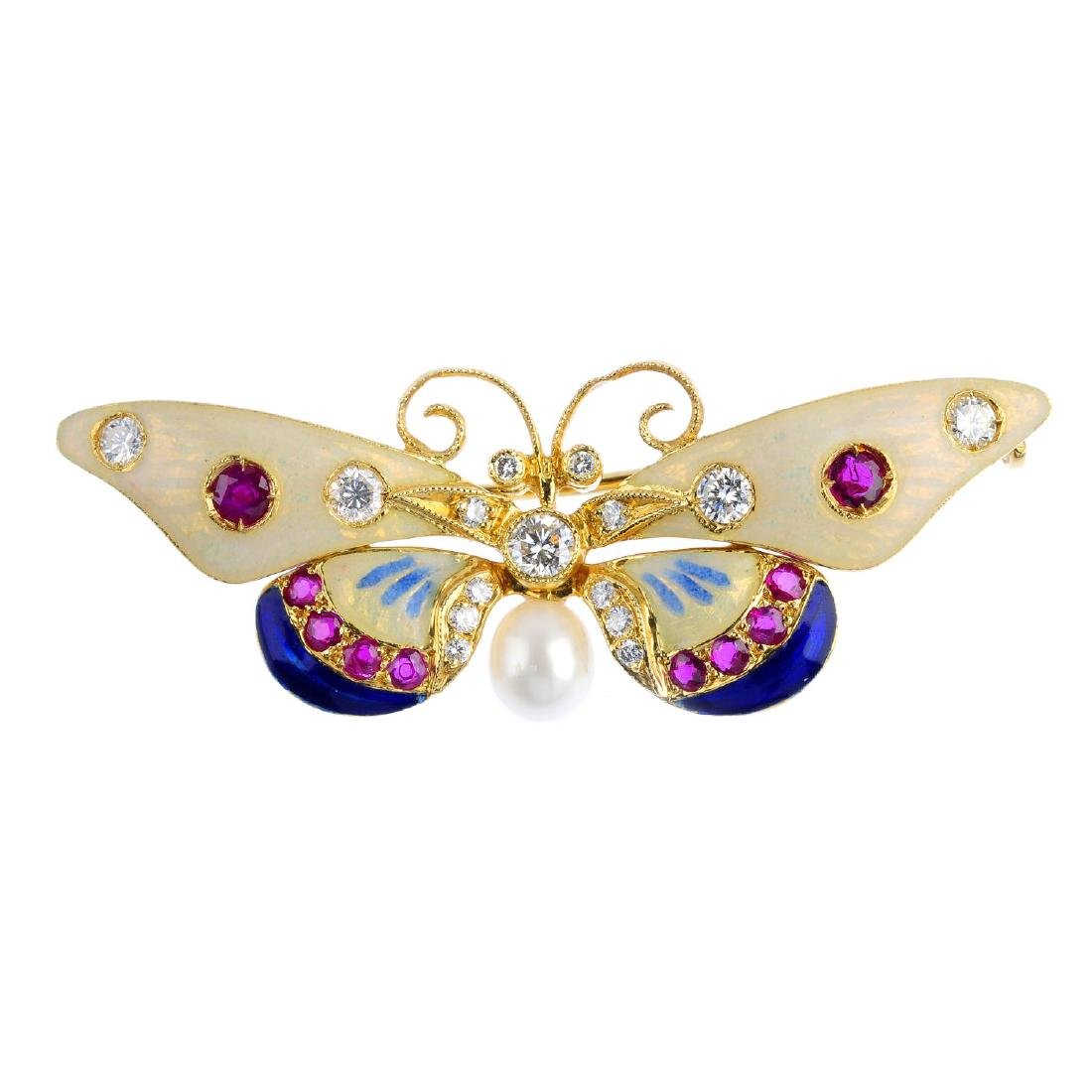 A diamond, ruby and enamel butterfly brooch. The