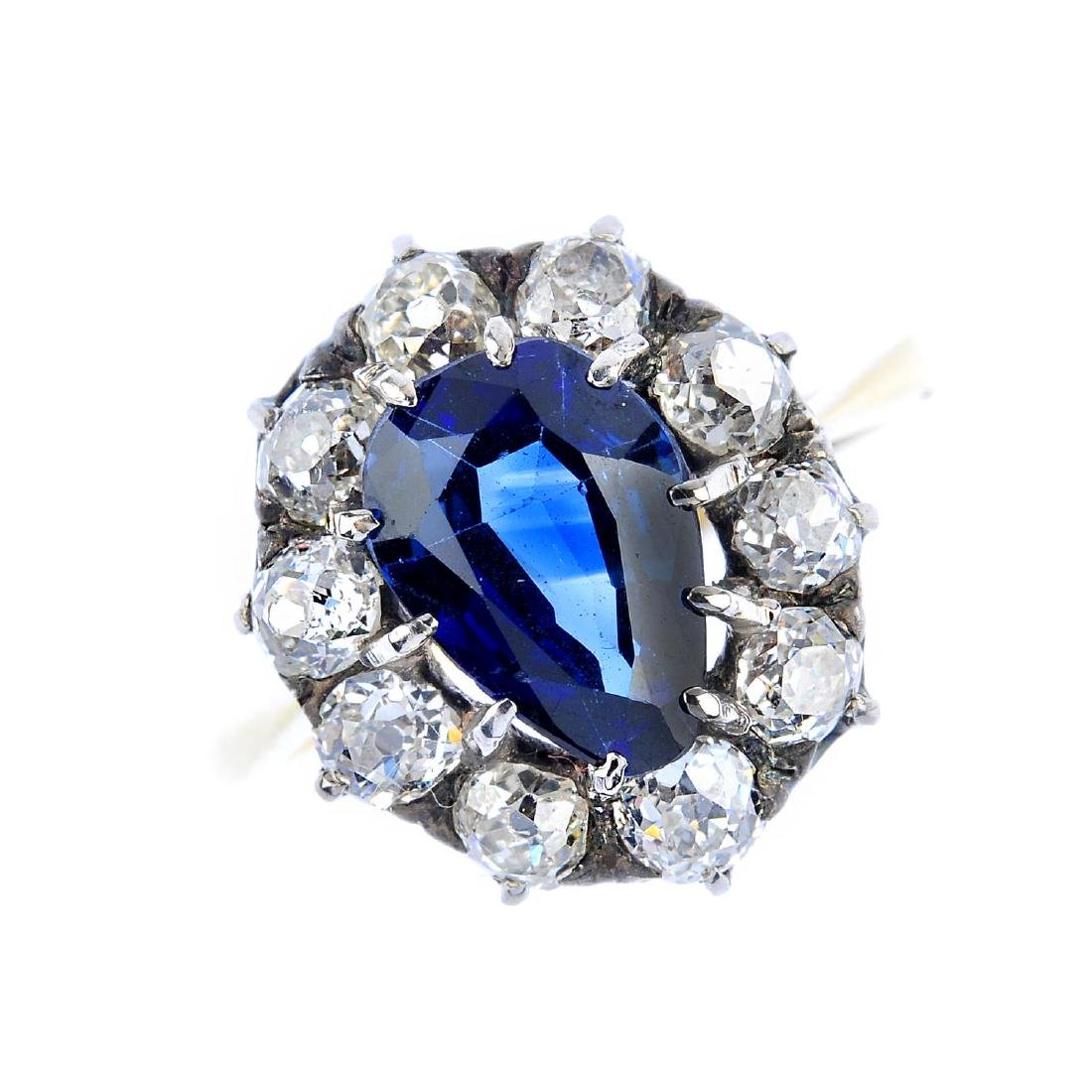 An early 20th century gold sapphire and diamond cluster