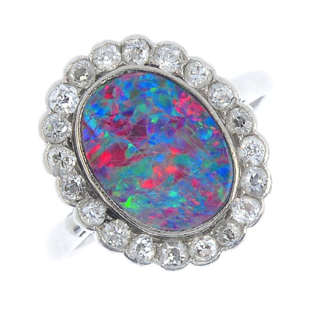 An early 20th century platinum, opal doublet and