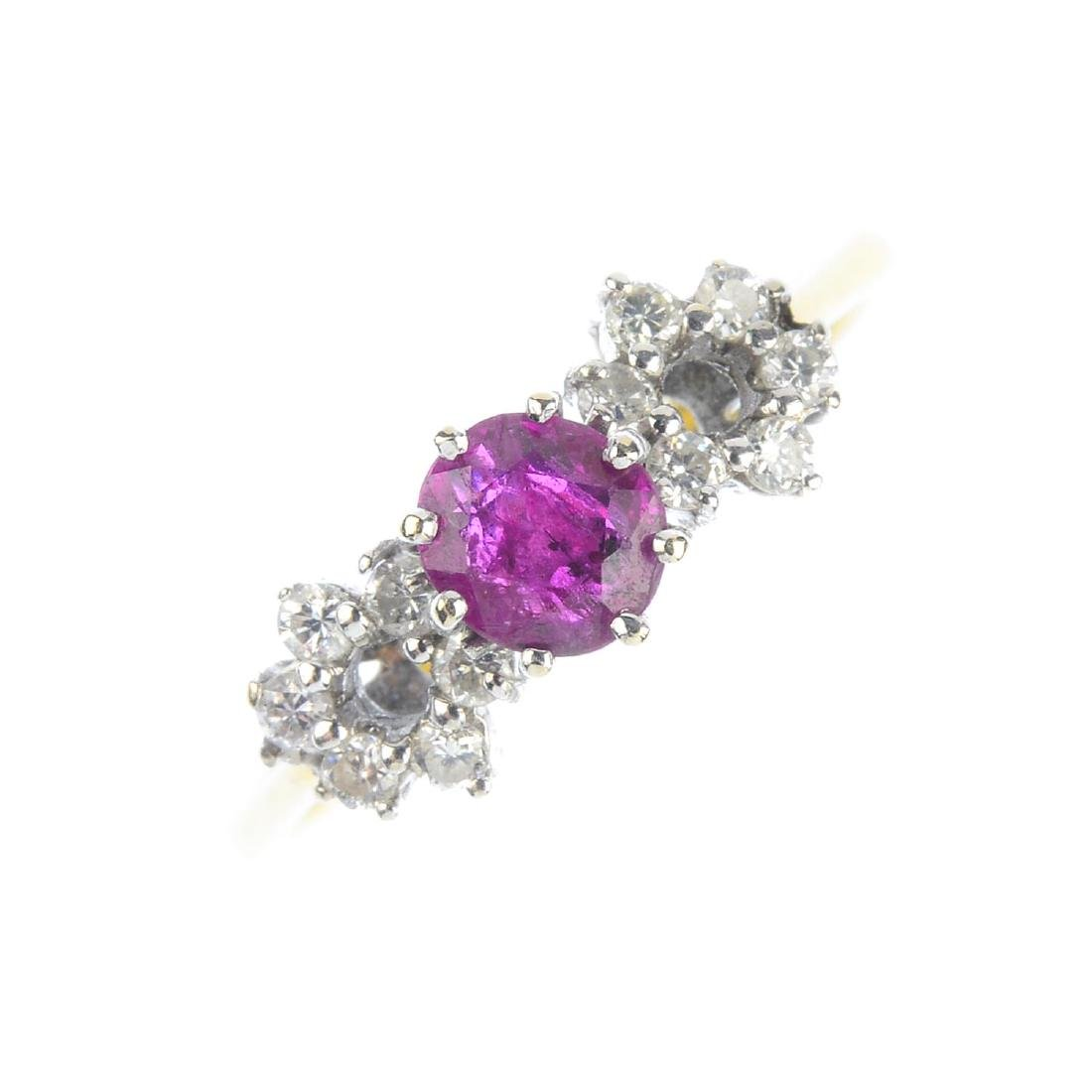 A ruby and diamond ring. The oval-shape ruby, with