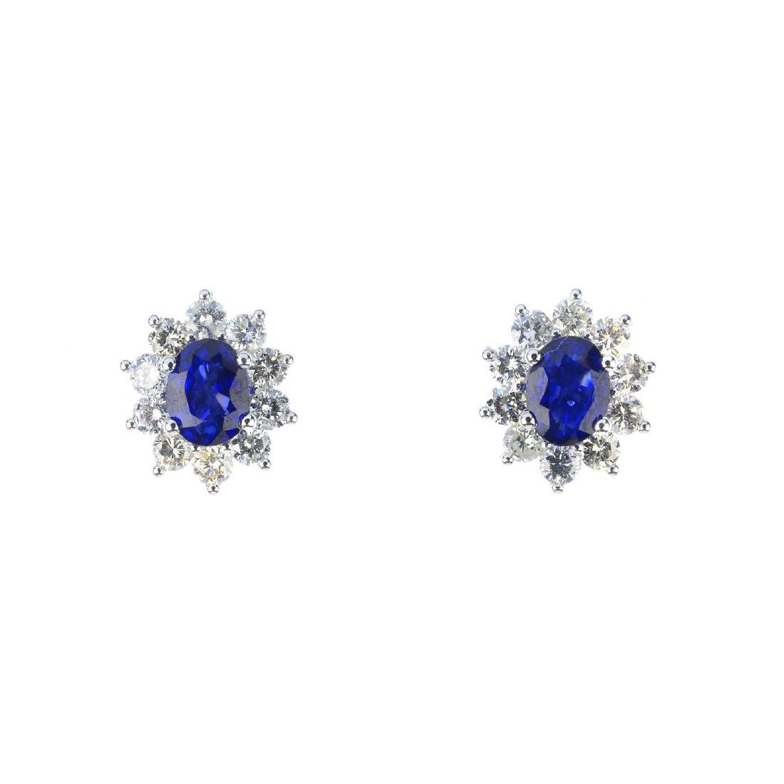 A pair of sapphire and diamond cluster earrings. Each