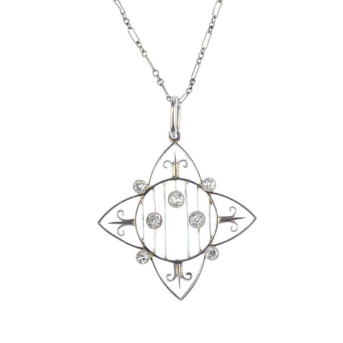 An Edwardian platinum and diamond pendant. Of openwork