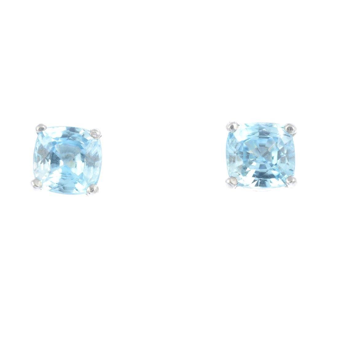 A pair of 18ct gold cushion-shape blue zircon stud
