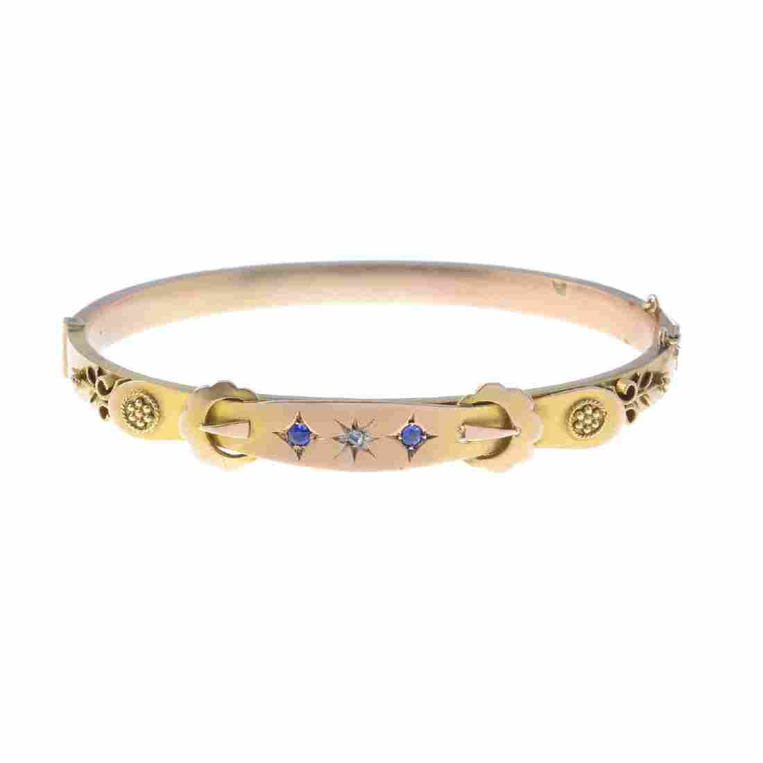 A late Victorian 9ct gold diamond and gem-set bangle.