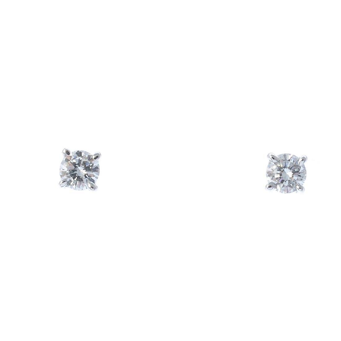 A pair of 9ct gold brilliant-cut diamond stud earrings.