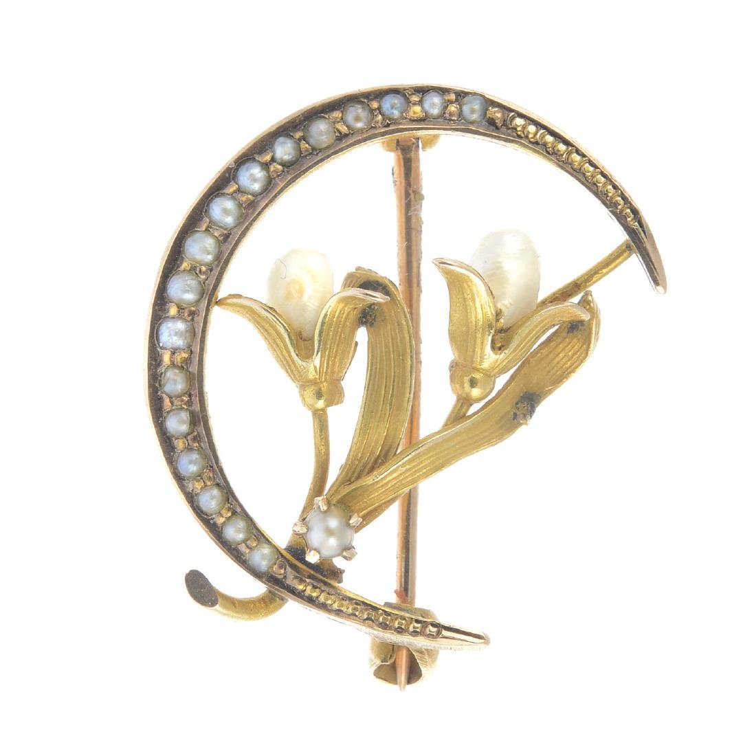 An Art Nouveau gold pearl brooch. Designed as two