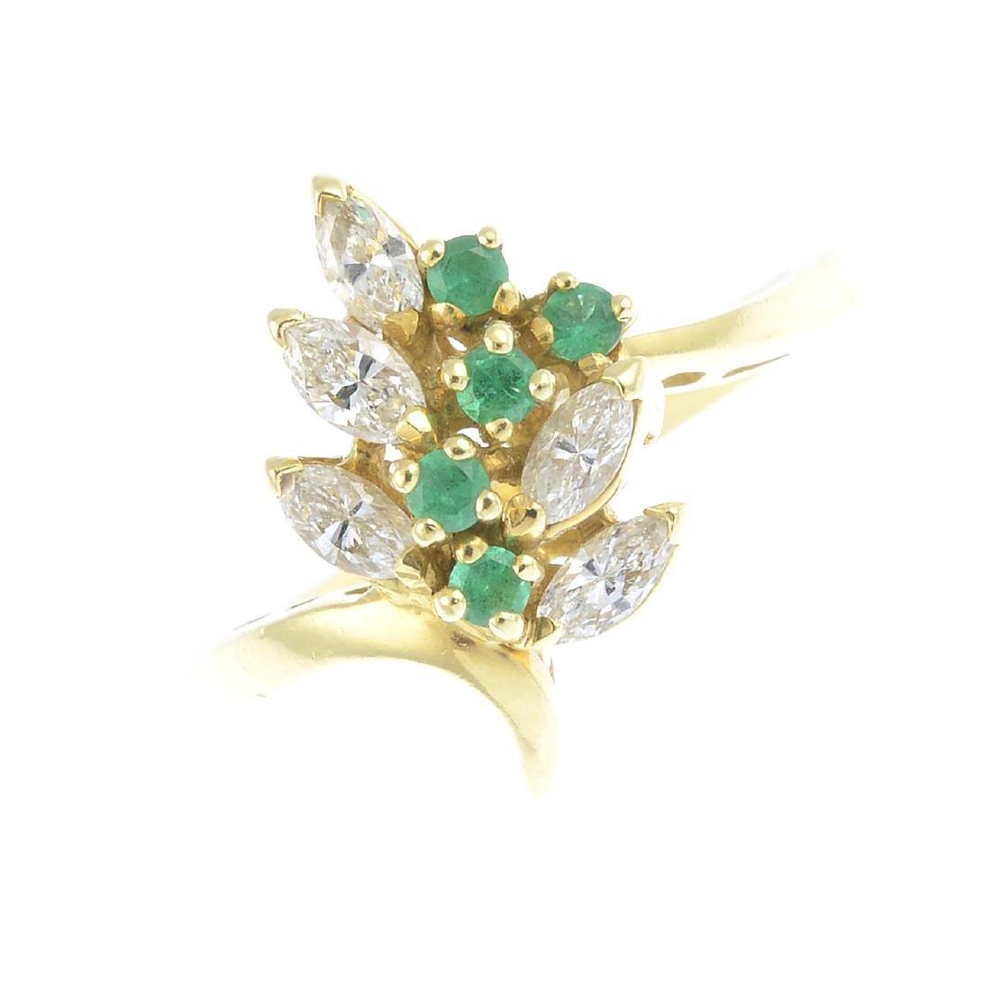 An emerald and diamond dress ring. Of foliate design,
