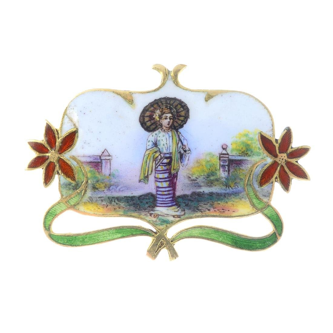 An early 20th century gold enamel brooch. The