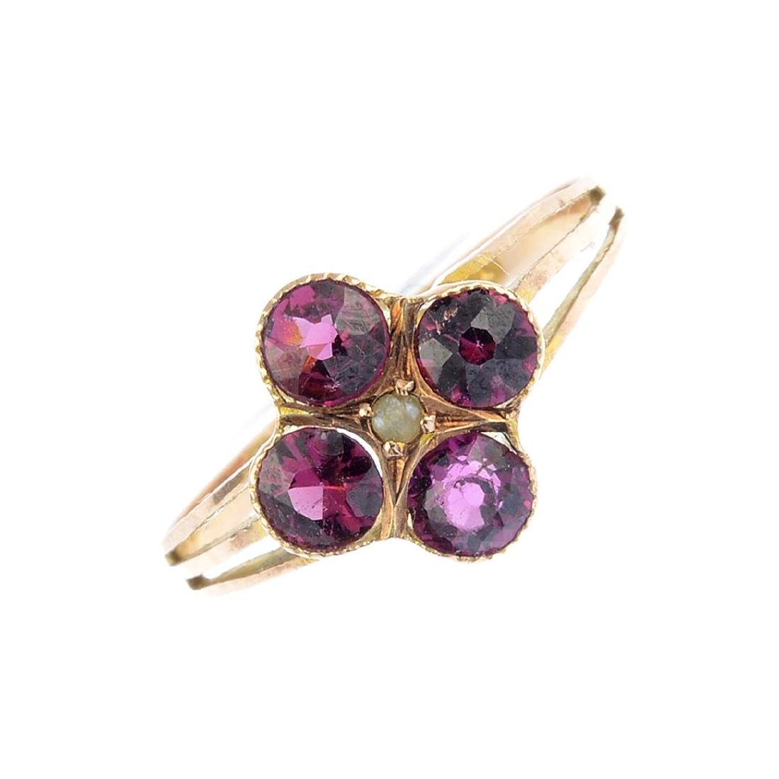 An early 20th century 9ct gold garnet and split pearl
