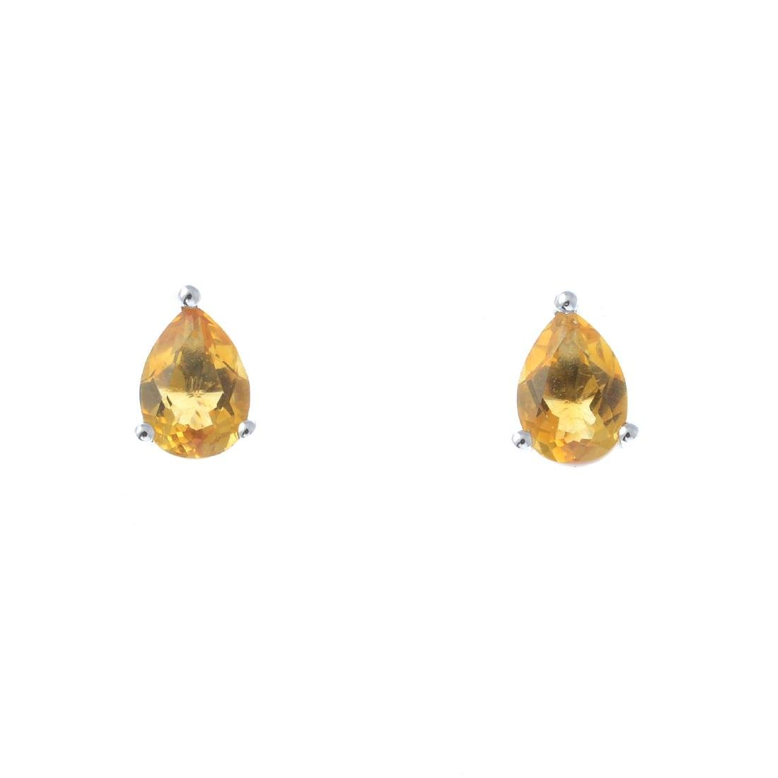 A pair of 9ct gold pear-shape citrine single-stone stud