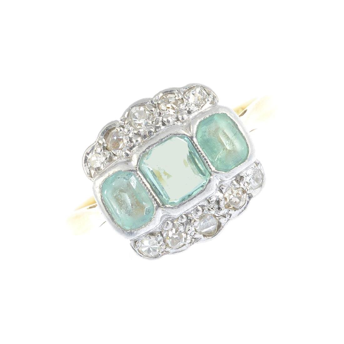 An early 20th century platinum and 18ct gold emerald