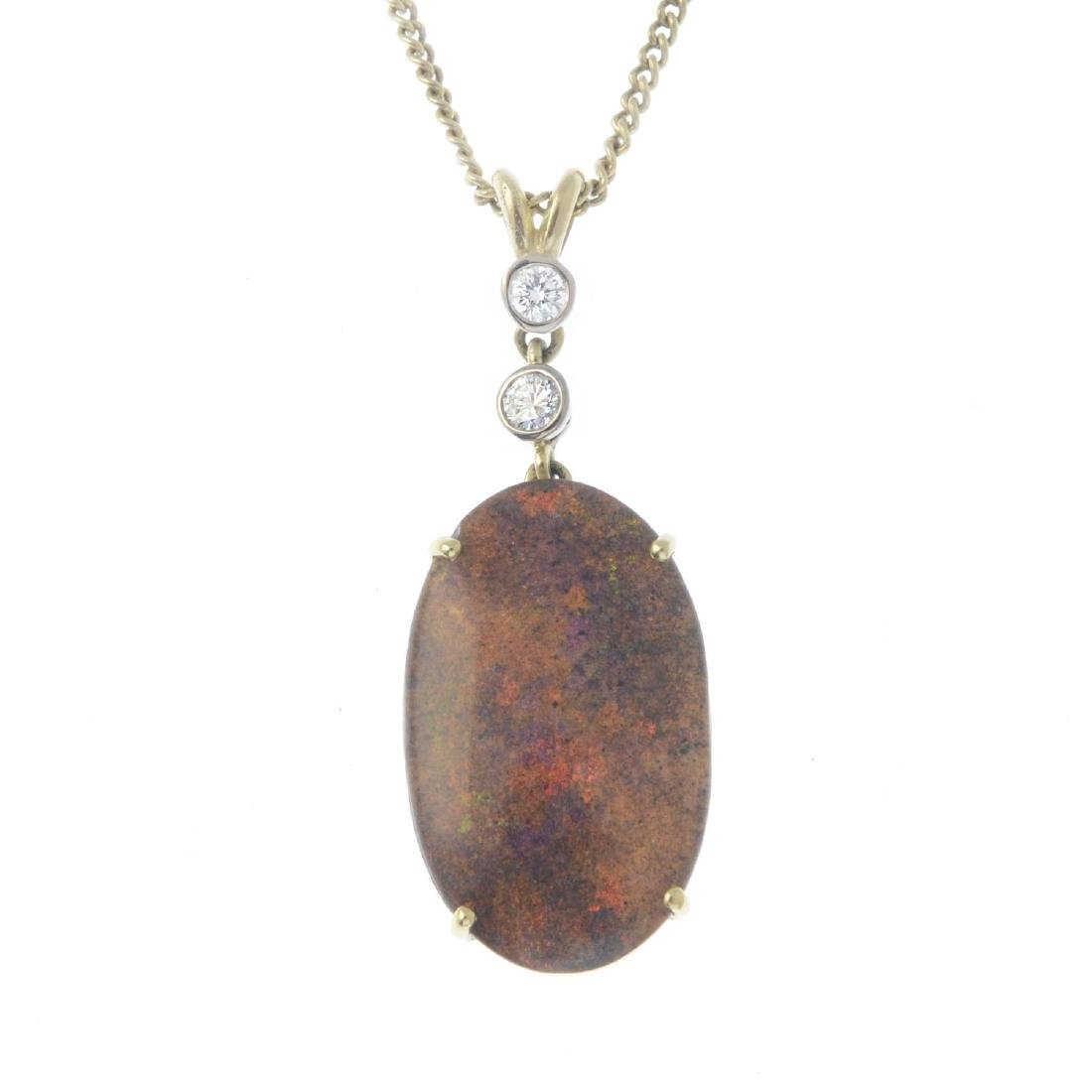 An 18ct gold opal doublet and diamond pendant. The oval