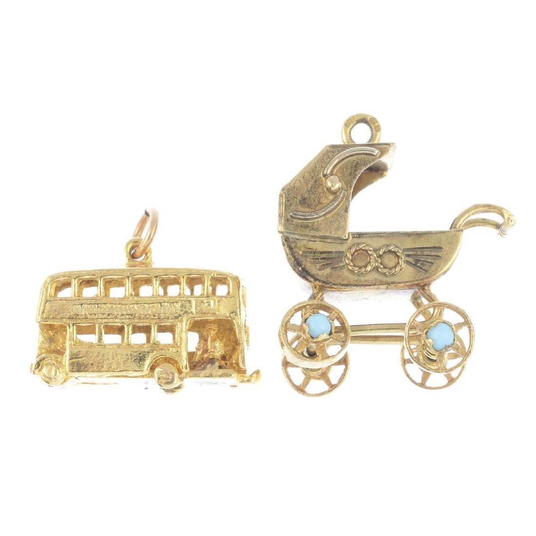 Two 9ct gold charms. To include a pram with blue gem