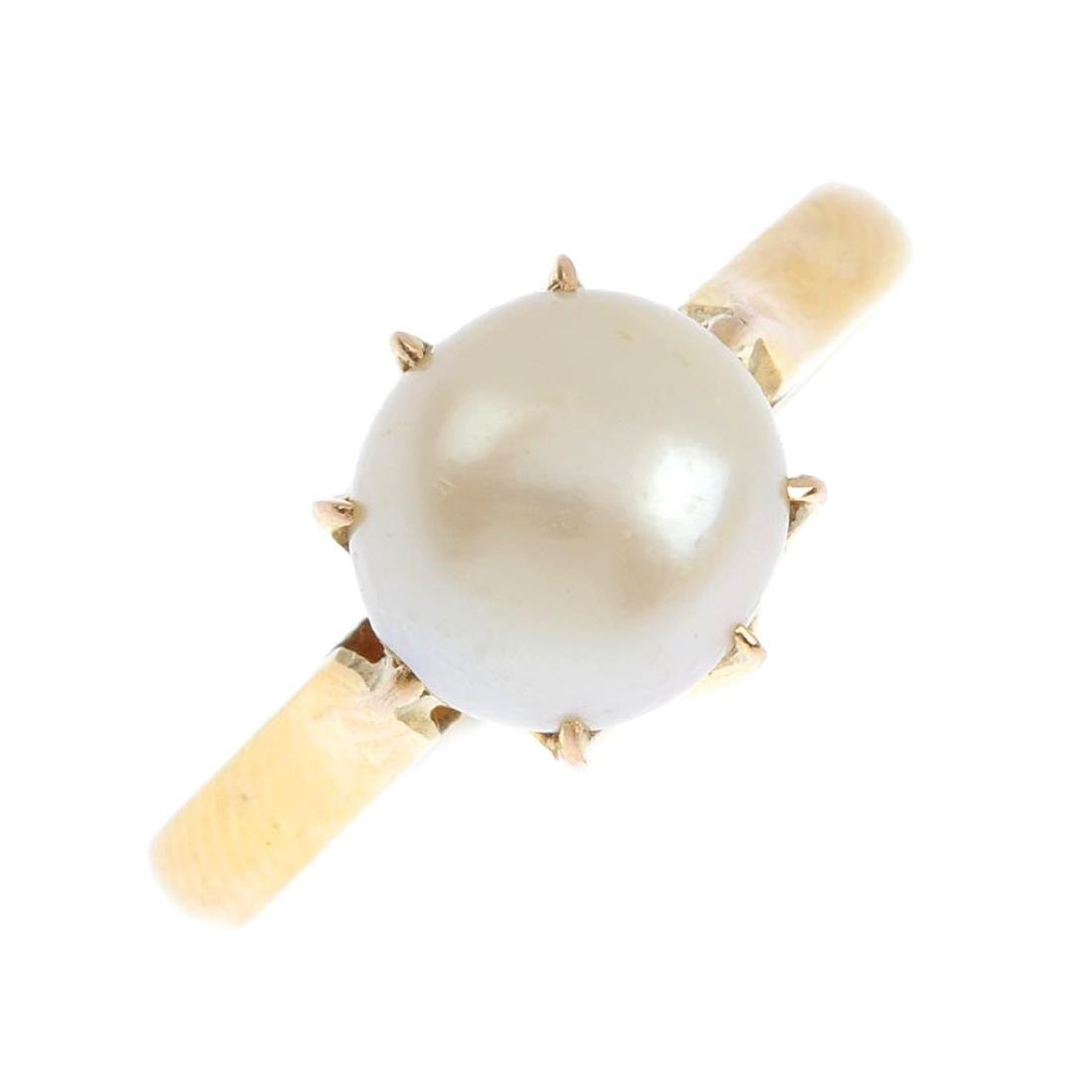 A cultured pearl ring. The cultured pearls, measuring