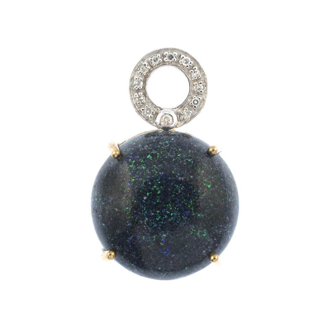 A treated opal and diamond pendant. The circular