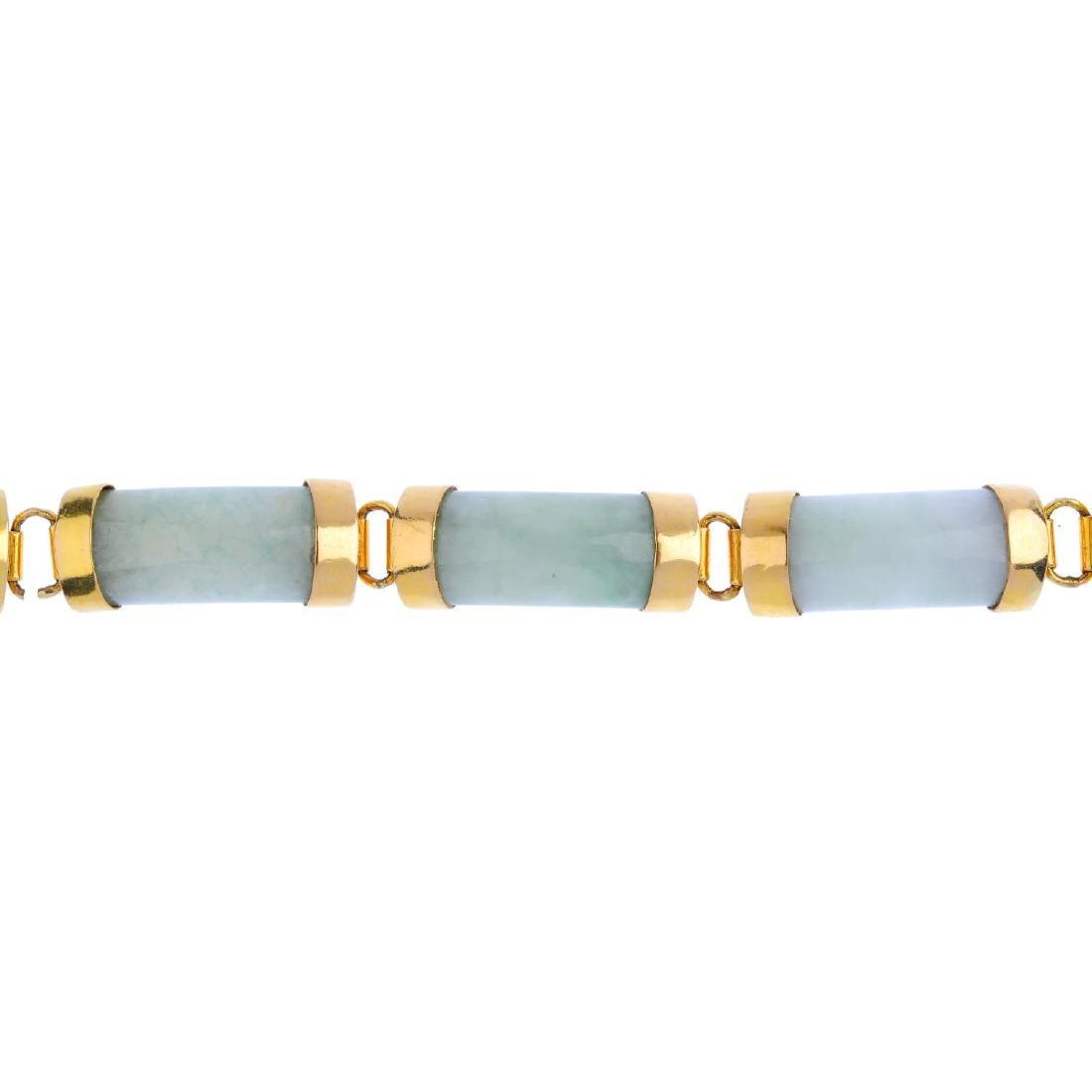 A jade bracelet. Designed as a series of curved jadeite