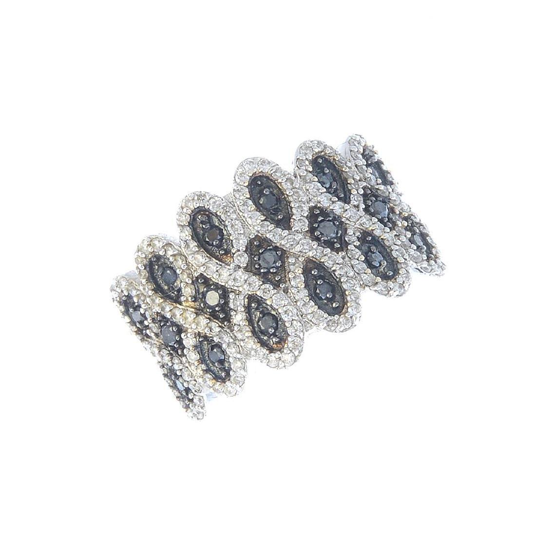 A diamond and gem-set dress ring. Designed as a series