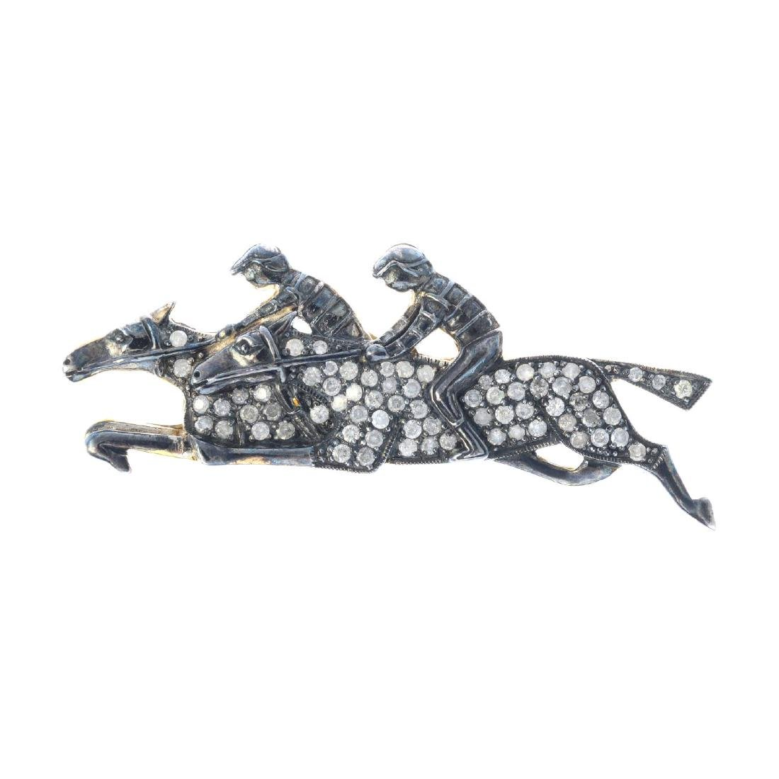 A diamond horse and jockey brooch. Designed as two