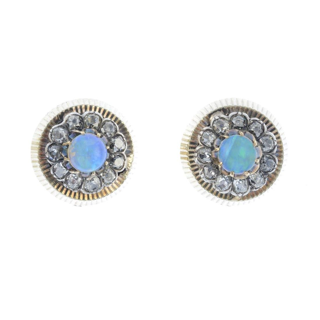 A pair of opal and diamond earrings. Each designed as a