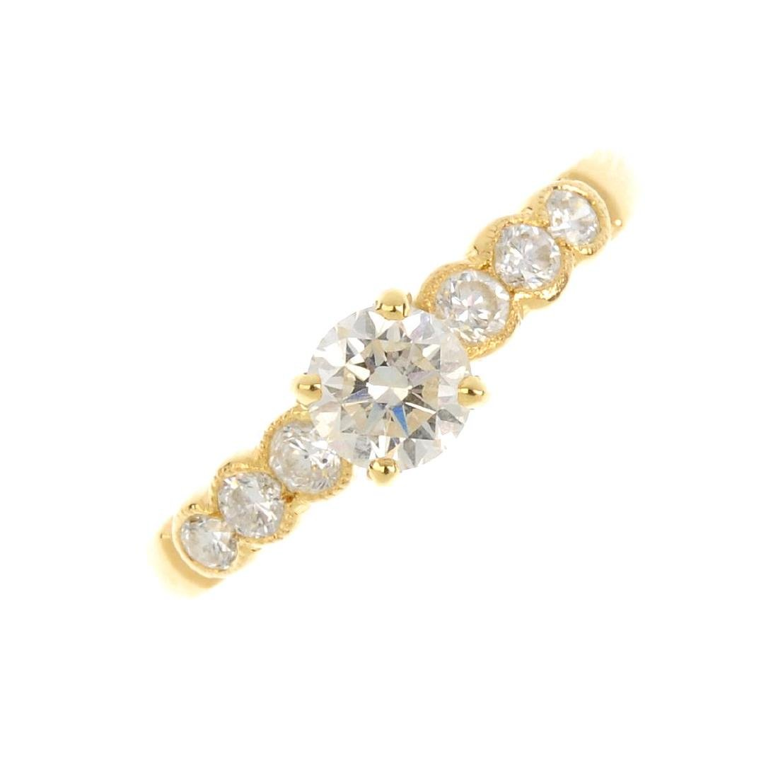 A 18ct gold diamond dress ring. Designed as a