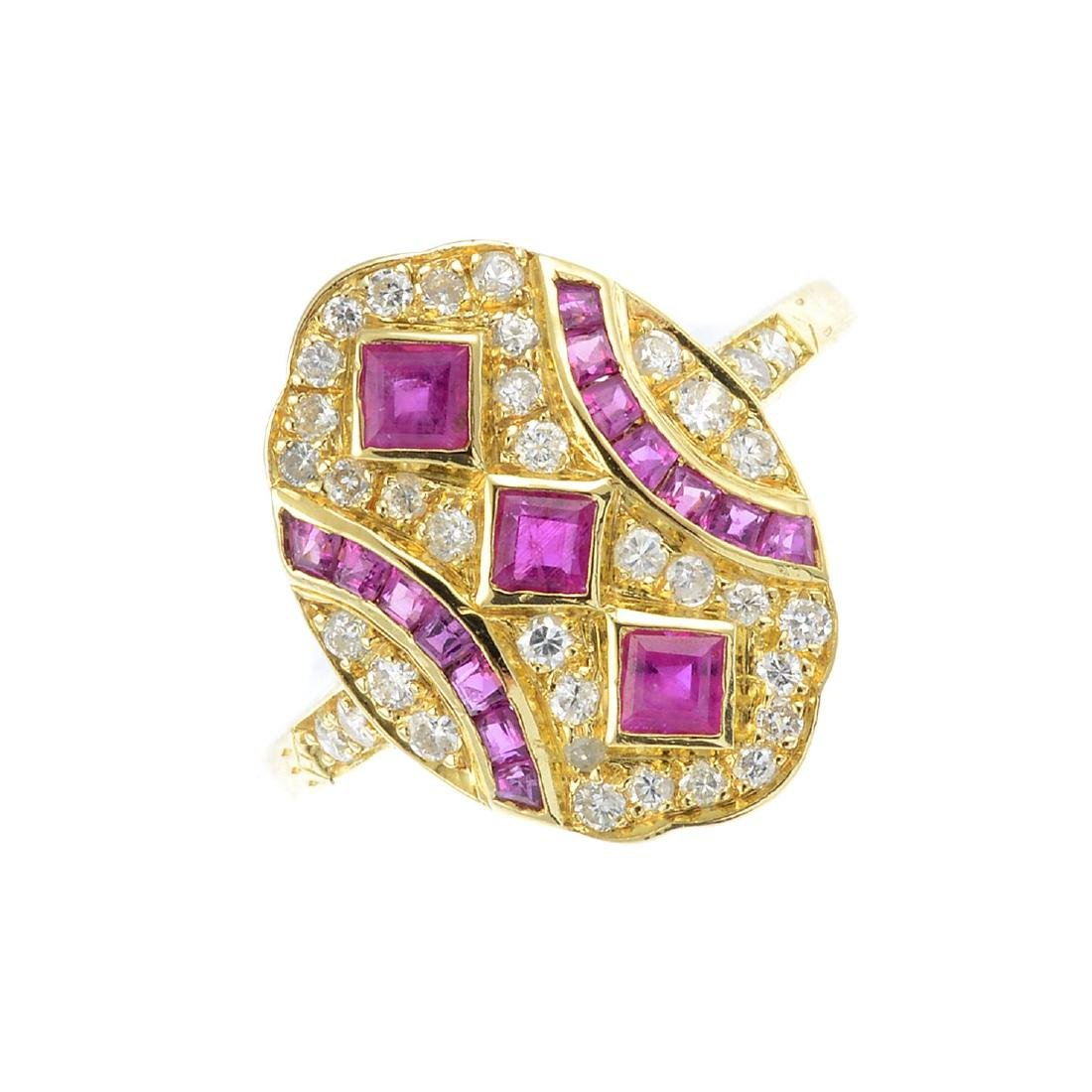 A ruby and diamond ring. Of marquise outline, the