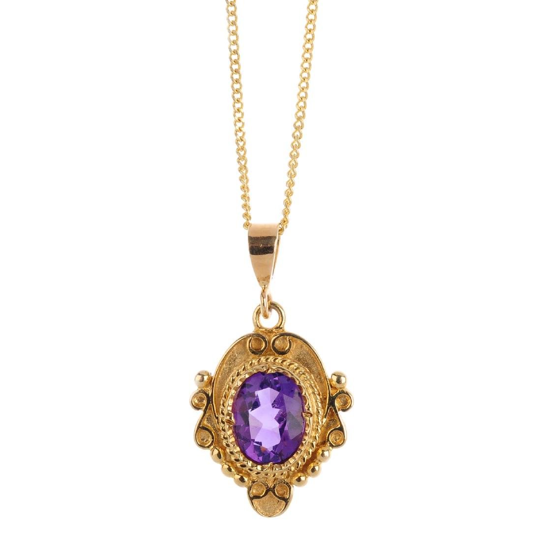 An amethyst pendant. The oval-shape amethyst, within a
