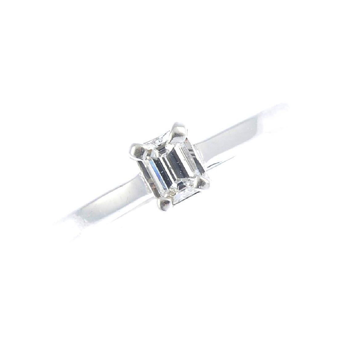A 9ct gold diamond single-stone ring. The baguette-cut