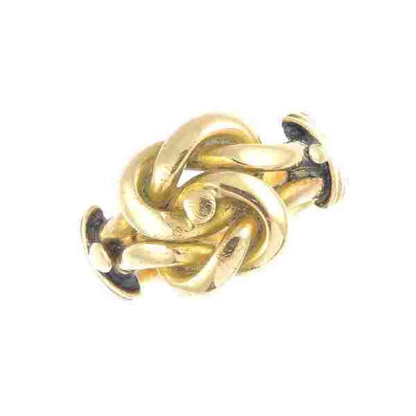 A late Victorian 18ct gold ring. Designed as a knot,