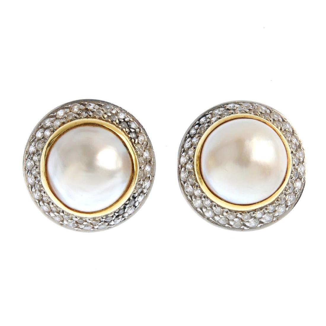 A pair of mabe pearl and cubic zirconia cluster