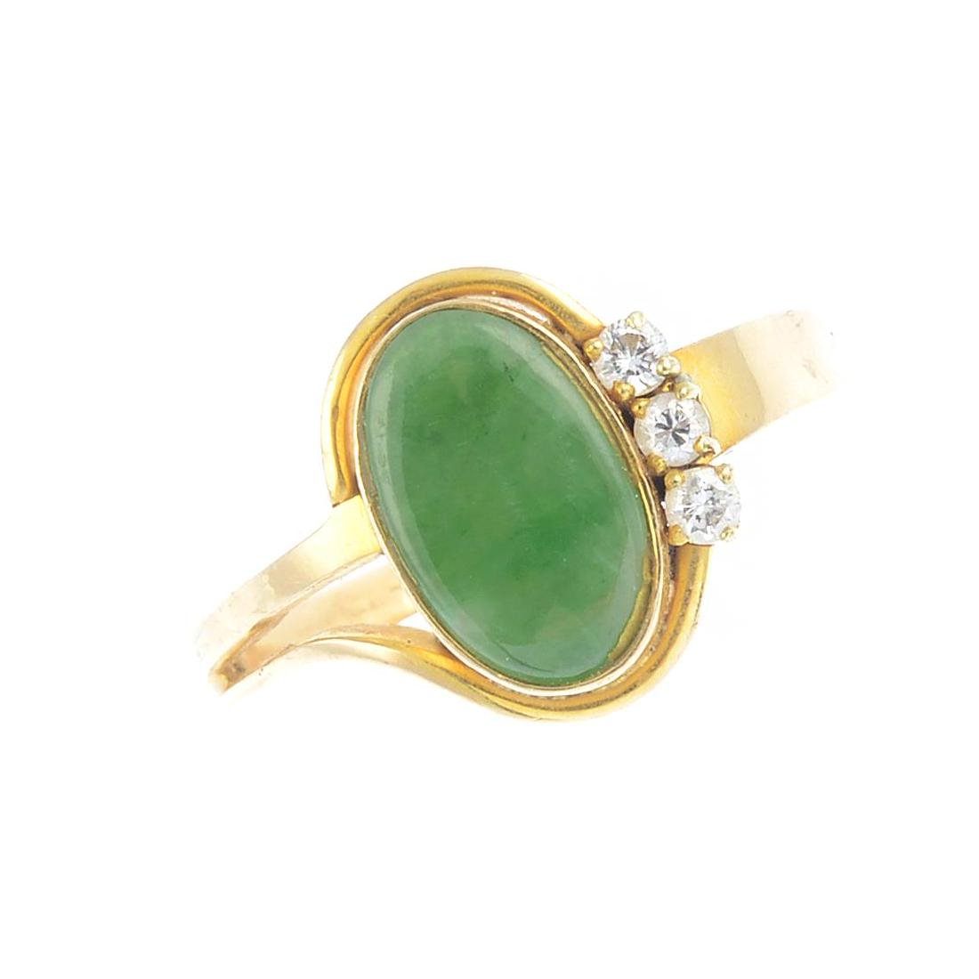 A jade and diamond dress ring. The oval jadeite