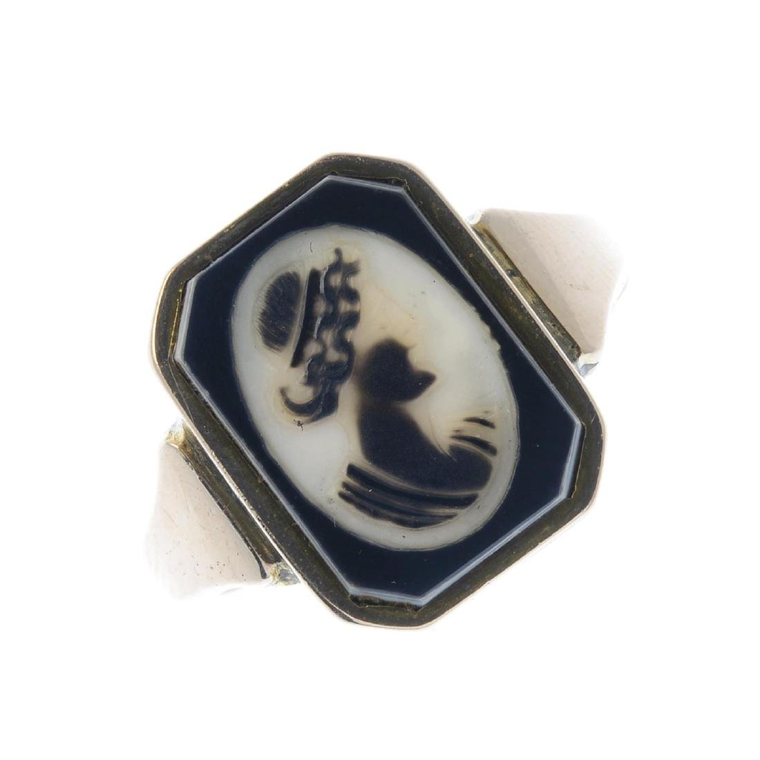 A mid 20th century onyx cameo signet ring. Designed as