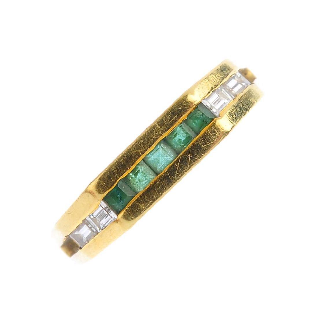 An emerald and diamond ring. Designed as a calibre-cut