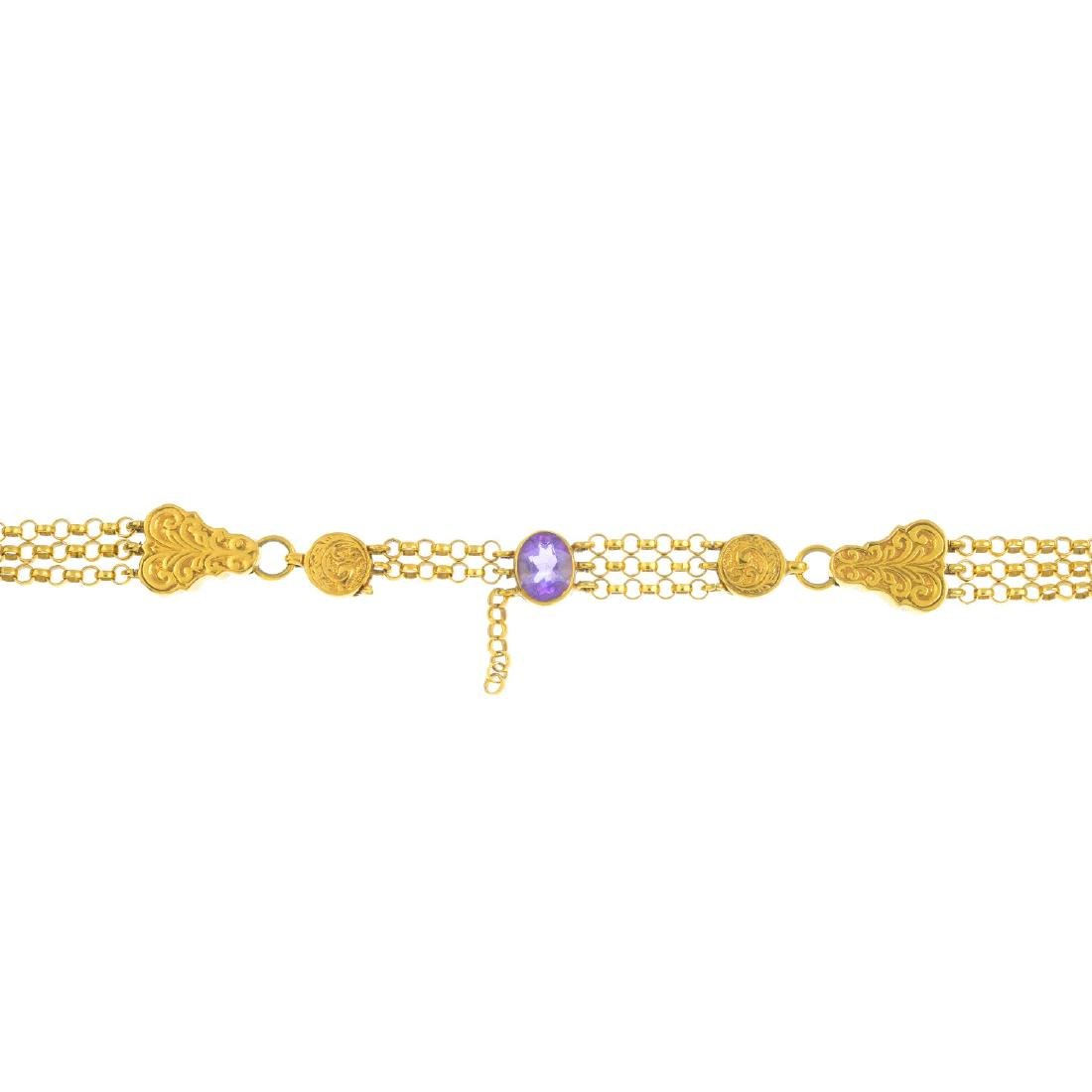 A 9ct gold amethyst bracelet. The oval-shape amethyst,