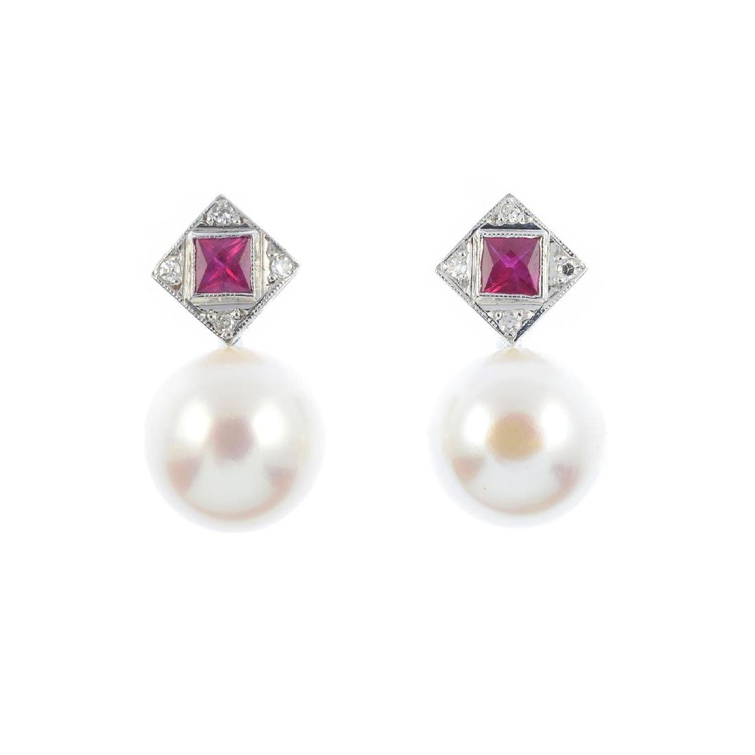A pair of cultured pearl and gem-set earrings. Each