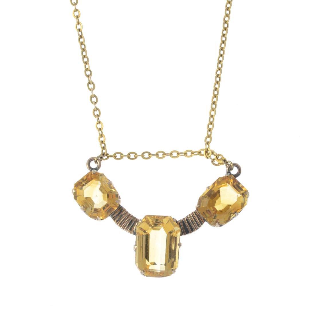 A citrine necklace. The rectangular-shape citrine line,