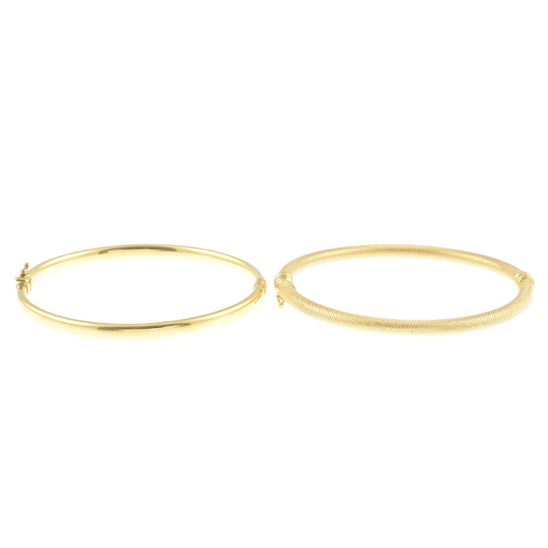 Two hinged bangles. To include a textured bangle and a