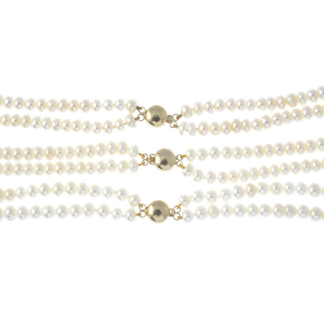 Three cultured pearl two-row necklaces. Each with