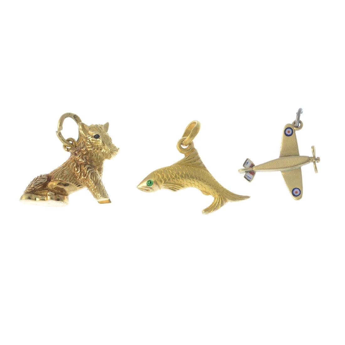 Four charms. To include a mid 20th century gold enamel