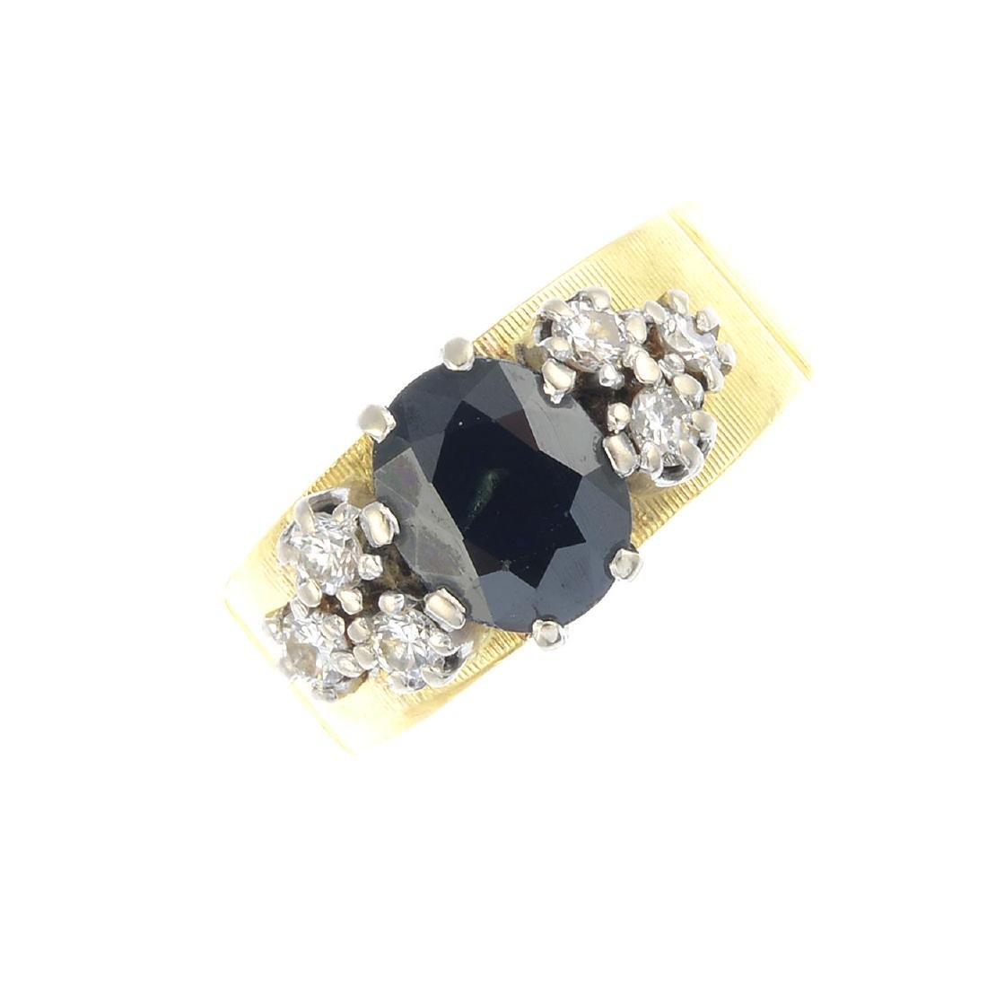A 1970s 18ct gold sapphire and diamond dress ring. The