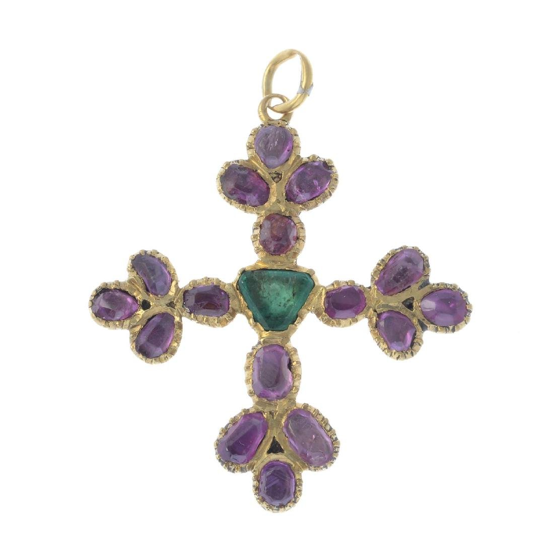 A ruby and emerald cross pendant. The triangular-shape