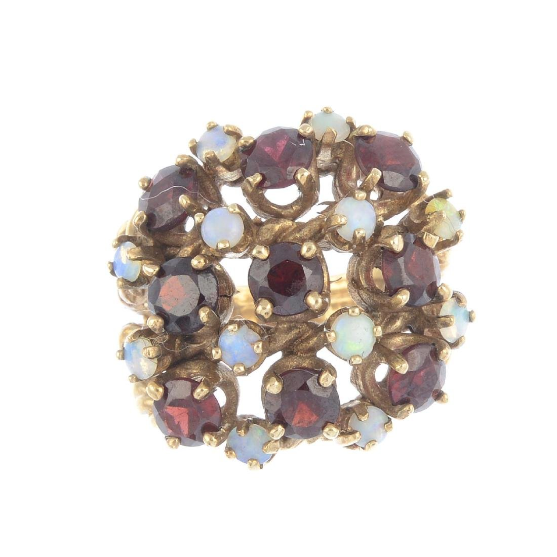 A 1970s 9ct gold garnet and opal dress ring. Of