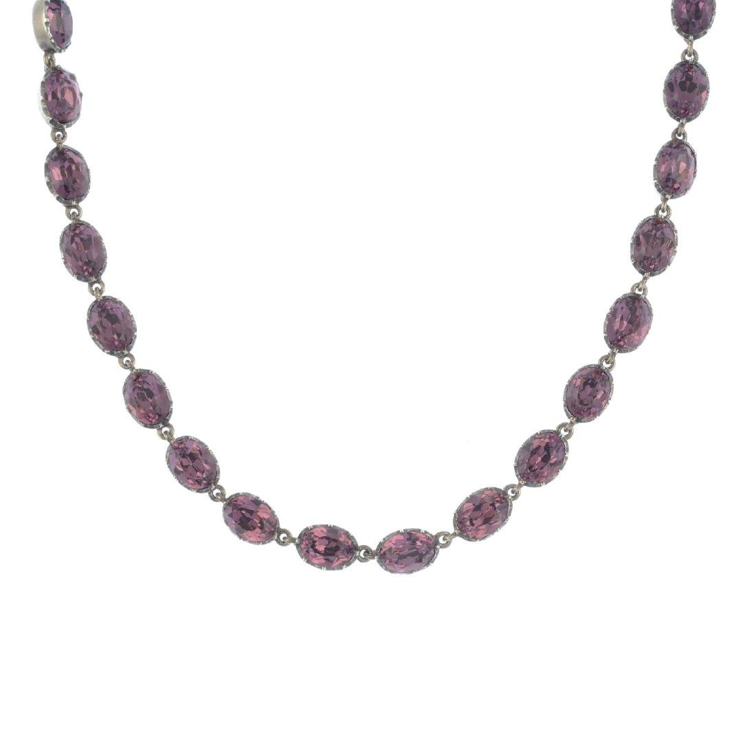 An amethyst necklace. Designed as a series of