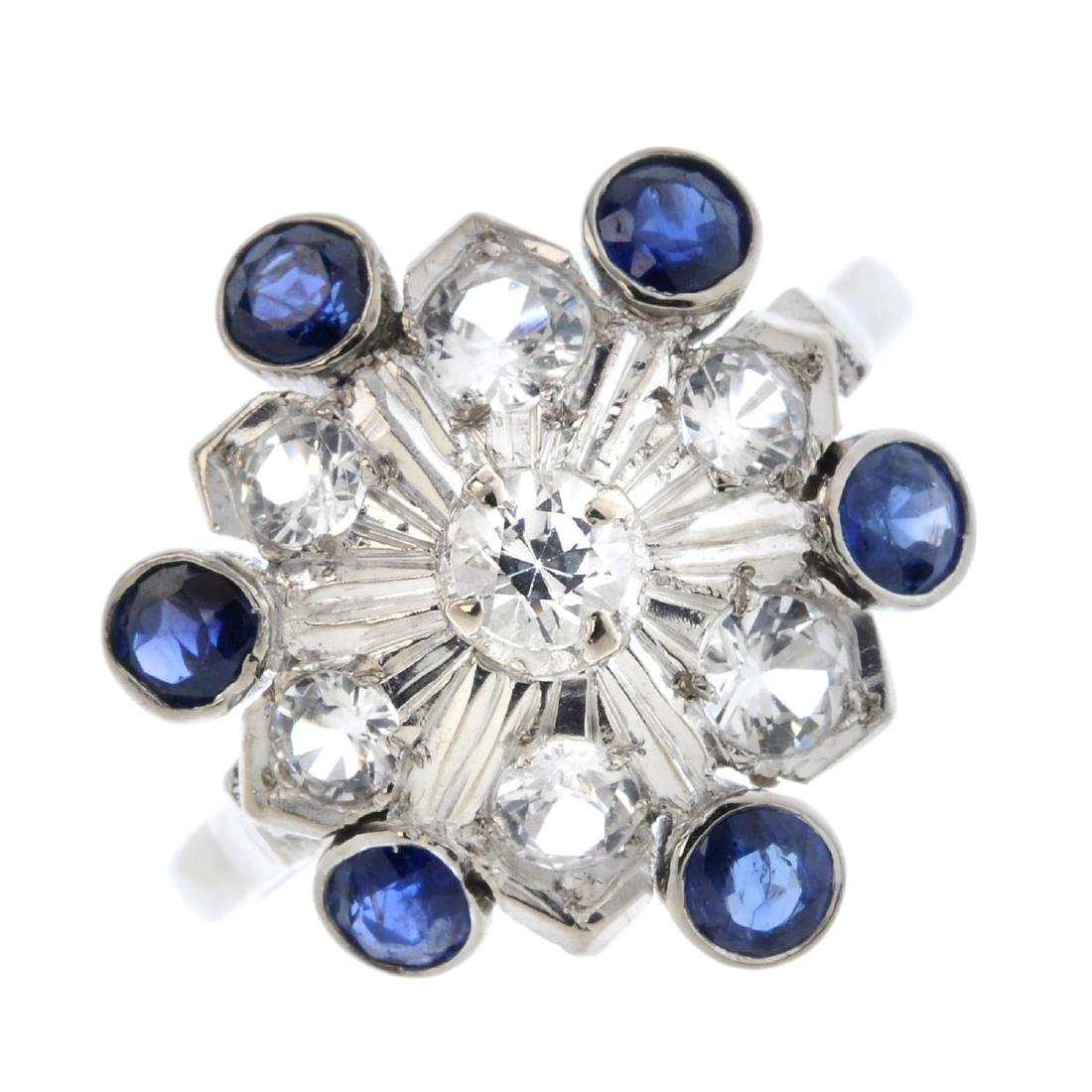 A sapphire and colourless gem cluster ring. The