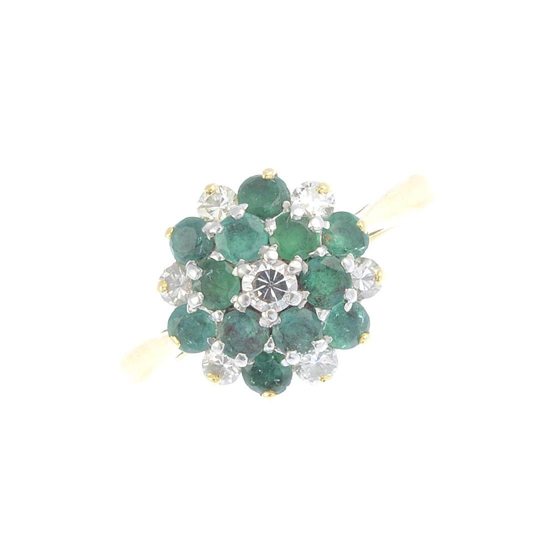 A 1960s 18ct gold emerald and diamond ring. Designed as