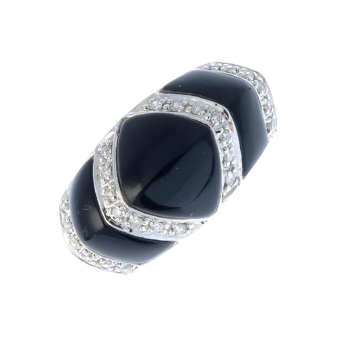 An onyx and diamond ring. The back onyx geometric